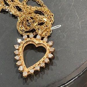 14k gold diamond pendant and chain.